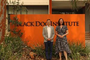 Felicity Stening standing outside Black Dog Institute building with a Black Dog Institute Partner